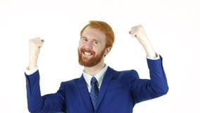 Hombre de negocios rojo emocionado Celebrating Success de la barba del pelo Imágenes de archivo libres de regalías