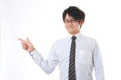 Hombre de negocios a señalar en Imagen de archivo libre de regalías