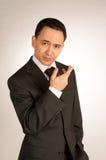 Hombre de negocios seguro de sí mismo joven en un juego Imagen de archivo libre de regalías