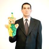 Hombre de negocios serio con la marioneta Imágenes de archivo libres de regalías