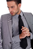 Hombre de negocios serio con su medio juego weared Fotografía de archivo