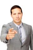 Hombre de negocios serio que señala en la cámara Imágenes de archivo libres de regalías