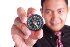 Hombre de negocios Showing Compass Foto de archivo
