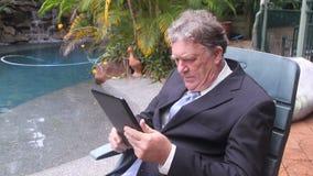 Hombre de negocios Sits In Chair almacen de metraje de vídeo