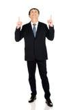 Hombre de negocios sonriente con el casco que destaca Fotografía de archivo libre de regalías