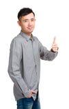 Hombre de negocios sonriente con el pulgar para arriba Fotos de archivo libres de regalías