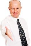 Hombre de negocios sonriente listo para una sacudida de la mano Imagenes de archivo
