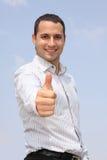 Hombre de negocios sonriente que muestra OK Foto de archivo