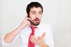hombre de negocios con un teléfono Foto de archivo libre de regalías