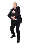 Hombre de negocios sospechoso que sostiene su cartera Imagen de archivo libre de regalías