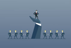 Hombre de negocios Standing Up On grupo Boss Leadership Concept de With Business People del líder de la mano grande ilustración del vector