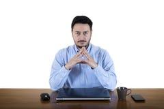 Hombre de negocios Staring At Employee imagen de archivo