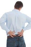 Hombre de negocios Suffering Back Pain aislado en blanco Imágenes de archivo libres de regalías