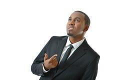 Hombre de negocios Thinking y el gesticular Imagen de archivo libre de regalías