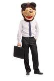 Hombre de negocios tonto que lleva una máscara infantil del oso Imágenes de archivo libres de regalías