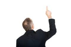 Hombre de negocios trasero de la visión que señala hacia arriba Imagenes de archivo