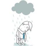 Hombre de negocios triste que se coloca en la lluvia Fotos de archivo libres de regalías
