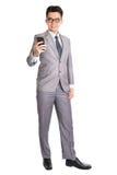 Hombre de negocios usando el teléfono elegante Foto de archivo