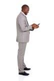Hombre de negocios usando el teléfono elegante Imagen de archivo