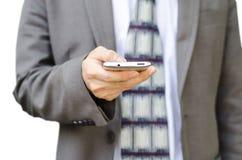 Hombre de negocios usando el teléfono elegante móvil Fotos de archivo