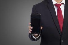 Hombre de negocios usando el teléfono elegante móvil Fotografía de archivo libre de regalías