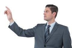 Hombre de negocios usando la pantalla digital futurista Fotos de archivo