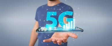 Hombre de negocios usando la red 5G con la representación del teléfono móvil 3D Fotos de archivo