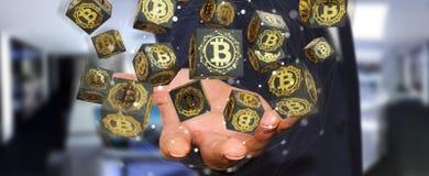 Hombre de negocios usando la representación del cryptocurrency 3D de los bitcoins Imagen de archivo