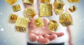 Hombre de negocios usando la representación del cryptocurrency 3D de los bitcoins Foto de archivo libre de regalías