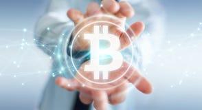 Hombre de negocios usando la representación del cryptocurrency 3D de los bitcoins Imagen de archivo libre de regalías