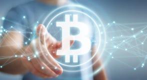Hombre de negocios usando la representación del cryptocurrency 3D de los bitcoins Imágenes de archivo libres de regalías