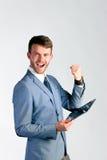 Hombre de negocios usando la tableta Foto de archivo libre de regalías