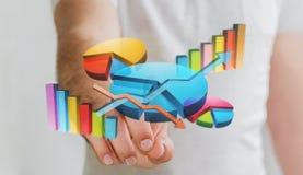 Hombre de negocios usando las cartas 3D y las barras digitales Foto de archivo libre de regalías