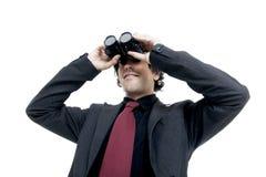 Hombre de negocios usando los prismáticos Fotografía de archivo libre de regalías