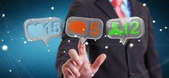 Hombre de negocios usando medios renderi social colorido digital de los iconos 3D Fotos de archivo libres de regalías
