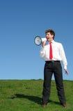 Hombre de negocios usando un megáfono Imagen de archivo