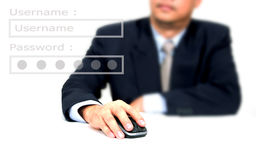 Hombre de negocios usando un ratón Fotos de archivo libres de regalías