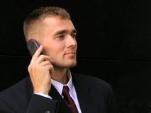 Hombre de negocios usando un teléfono móvil Foto de archivo