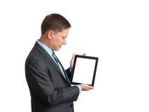 Hombre de negocios usando una PC de la tablilla Foto de archivo libre de regalías