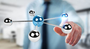 Hombre de negocios usando volar la representación de la red 3D de las esferas 3D Fotografía de archivo