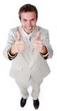 Hombre de negocios victorioso con los pulgares para arriba Foto de archivo libre de regalías