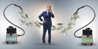 Hombre de negocios y aspirador que chupa el dinero fuera de él fotografía de archivo libre de regalías