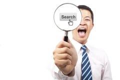 Hombre de negocios y búsqueda del Internet Imagen de archivo