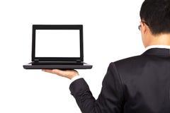 Hombre de negocios y computadora portátil Fotografía de archivo