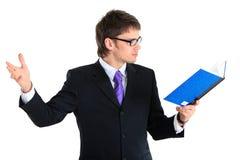 Hombre de negocios y cuaderno. Cierre para arriba Fotos de archivo libres de regalías
