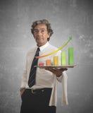Hombre de negocios y estadísticas positivas Fotos de archivo