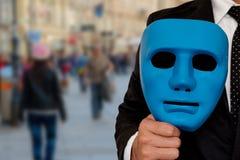 Hombre de negocios y máscara foto de archivo libre de regalías