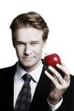 Hombre de negocios y manzana Imágenes de archivo libres de regalías