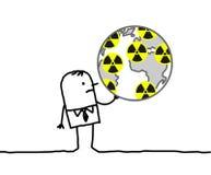 Hombre de negocios y mundo nuclear Imagenes de archivo