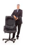 hombre de negocios y silla foto de archivo libre de regalías